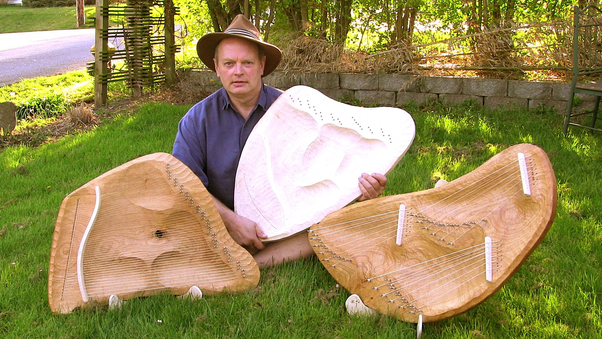 Dave with 3 of the Healing Lyres, (one under construction)